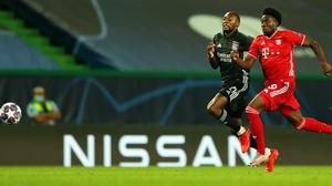Bayern Munich's Alphonso Davies (R) in action against Olympique Lyon's Karl Toko Ekambi