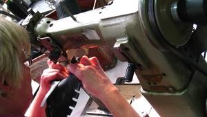 A sewing machine at Whelan Footwear