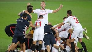 Sevilla players celebrate at full-time