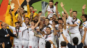 Sevilla celebrate with the Europa League trophy