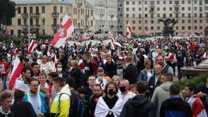 Waving red-and-white opposition flags, protesters demanded Mr Lukashenko's resignation and chanted 'freedom'