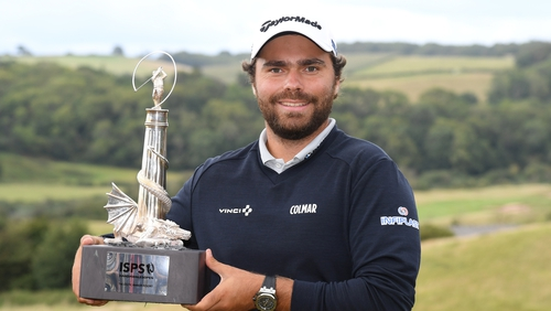 Romain Langasque poses with the trophy