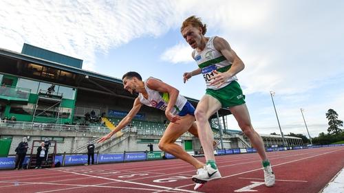 Paul Robinson of St Coca's AC, Kildare, left, crosses the finish line to win