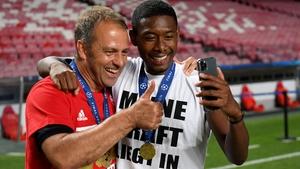 Hans-Dieter Flick celebrates with David Alaba