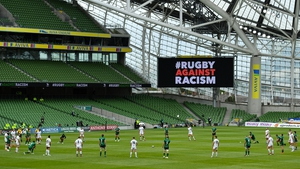 Ulster and Connacht players made an ant-racism gesture before the game