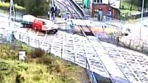 Footage shows the van crashing through the barrier