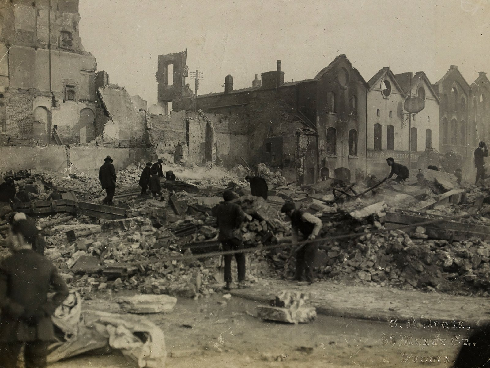 Image - The ruins of Cash's department store after its destruction by the Crown Forces. Image courtesy of the National Library of Ireland