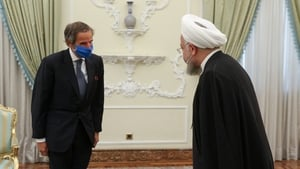 Iranian President Hassan Rouhani (R) meeting with Director General of the International Atomic Energy Agency (IAEA) Rafael Mariano Grossi (L) in Tehran