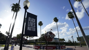 A Black Lives Matter banner hangs outside of the arena in Florida