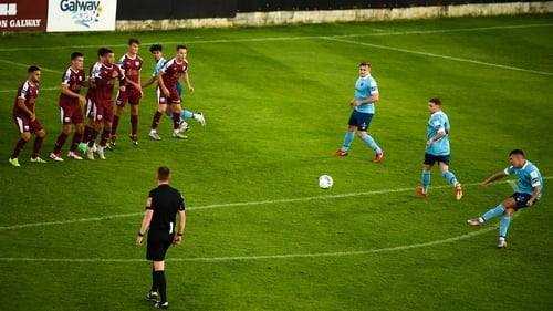 Dayle Rooney bends home the opener for Shels