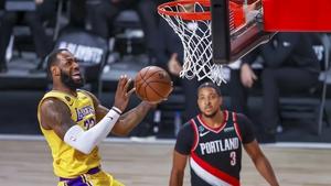 Los Angeles Lakers forward LeBron James (L) in action against Portland Trail Blazers guard CJ McCollum