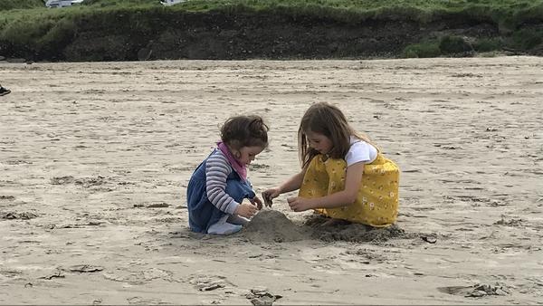 Children enjoying Enniscrone beach in Co Sligo
