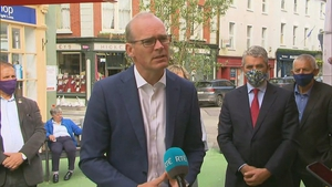 Simon Coveney said he would need to be convinced that he would add value to Ireland's profile within the commission