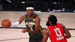 Shai Gilgeous-Alexander #2 of the Oklahoma City Thunder drives the ball against James Harden #13 of the Houston Rockets