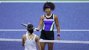 Naomi Osaka taps rackets after winning during her Women's Singles first round match against Misaki Doi