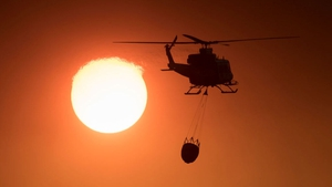 A helicopter prepares to drop water over the Spanish blaze