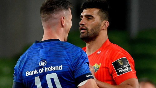 Damian de Allende (R) gets to know Johnny Sexton during the recent derby encounter