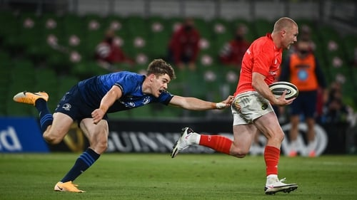 Keith Earls (R) makes a break against Leinster in the recent Pro14 meeting