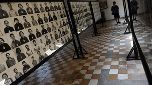 Photographs of prisoners on display at the genocide museum at Tuol Sleng, the former prison S-21 used by the Khmer Rouge to imprison and torture thousands of Cambodians during the 1970s, in Phnom Penh