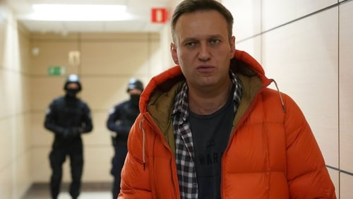 Alexei Navalny's condition improving, police guard stepped up