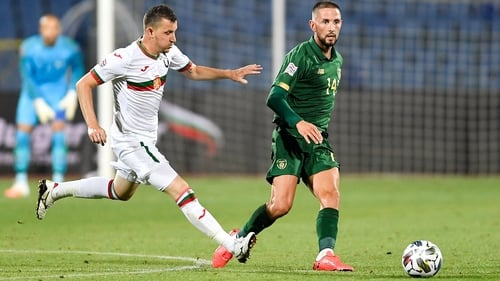 Conor Hourihane gets his pass off in Sofia before Todor Nedelev can intervene