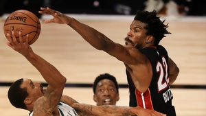 George Hill #3 of the Milwaukee Bucks drives to the basket against Jimmy Butler #22 of the Miami Heat