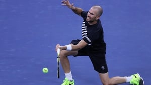 Adrian Mannarino of France returns a volley against Zverev