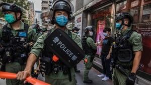 Police on patrol in Hong Kong amid flash protests against the decision to postpone legislative council elections