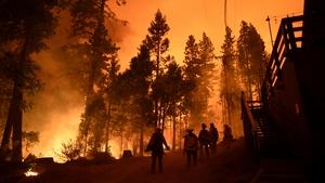 Firefighters battle the Creek Fire in Fresno, California