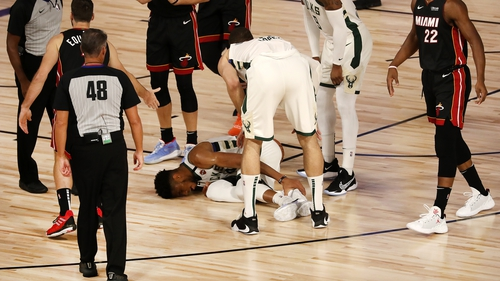 Bucks' star player Giannis Antetokounmpo went off injured in the first half