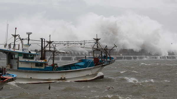 Large waves break over a coastal wall at Imwon harbour in Donnghae, Gangwon-do province, South Korea