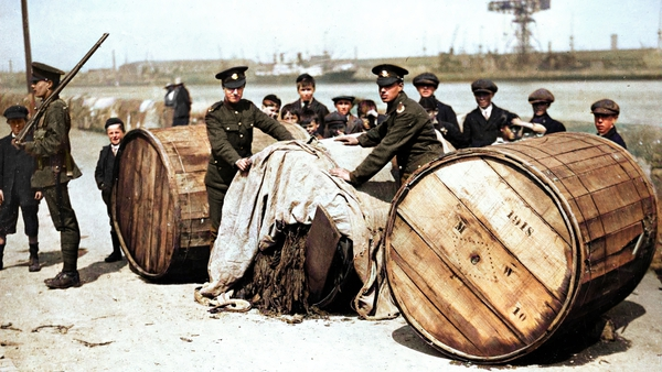 Soldiers guard tobacco kegs, May 1921