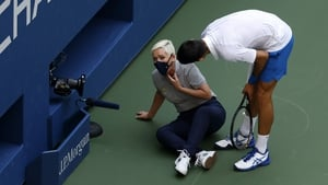 Djokovic checks on the line judge after hitting her with a ball