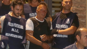Giuseppe Mastini (centre) took advantage of a temporary release from a high-security jail in Sardinia to flee, failing to return to his cell on Saturday (file pic)