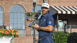 Dustin Johnson poses with the FedEx Cup