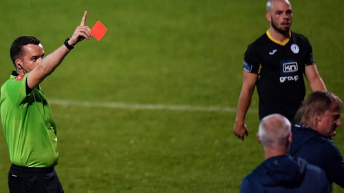 Horgan (r) was sent to the stand by the referee after his side were reduced to 10 men