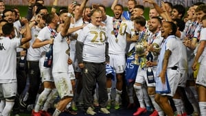 Marcelo Bielsa celebrates the Championship title with his players