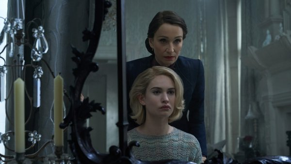 Kristen Scott Thomas as Mrs. Danvers with Lily James as Mrs. de Winter in Rebecca