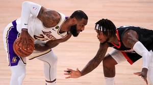 LeBron James of the Los Angeles Lakers is shielded by Ben McLemore of the Houston Rockets
