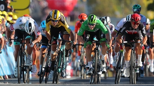 Bennett (in green) is edged out on the line by Ewan (in black) and Sagan (in white)