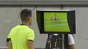Referee Carlos Del Cerro Grande reviews the VAR monitor during a Europa League fixture in August