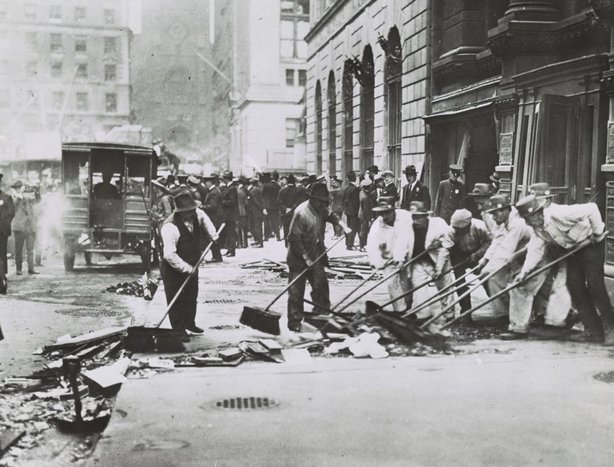 Sweeping up broken glass following Wall St. explosion in 1920, New York City Photo: Library of Congress