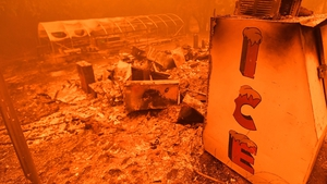 A singed ice machine sits over a burned store during the Bear fire, part of the North Lightning Complex fires, in unincorporated Butte County, California
