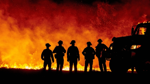 Firefighters watch as flames quickly spread in Oroville, California during Septembers wildfires