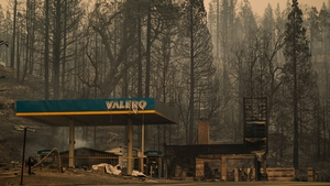 A burned Valero gas station smolders during the Creek fire in an area of Fresno County, California