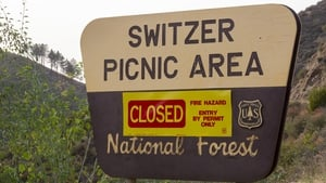 Signage warns residents that the Angeles National Forest is closed as the Bobcat Fire burns nearby on September 9, 2020 near Monrovia