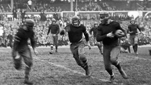 New York Giants running back Heinie Benkert in action against the Rochester Jeffersons in November 1925