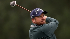 Shane Lowry hits his tee shot on the 14th