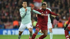 Thiago Alcantara (L) vies with Liverpool's Georginio Wijnaldum during the Champions League in 2019