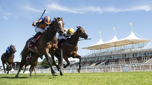 Fancy Blue ridden by Ryan Moore (left) wins The Qatar Nassau Stakes